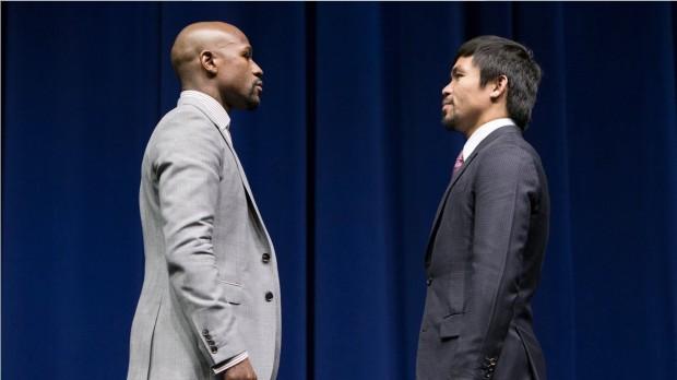 """Os lutadores americano Floyd Mayweather e o filipino Manny Pacquiao na coletiva de imprensa em Las Vegas. Eles se enfrentam amanhã na """"luta do século"""". (Foto: Divulgação)"""